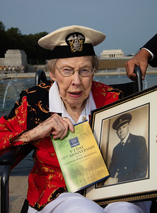 World War II veteran Gerry Korn holds a pictures of her later husband. Geraldine Lohman Corn, WWII veteran and U.S. Navy Nurse. After finishing training as a Registered Nurse in St. Louis in 1943, Geraldine Lohman and two fellow nurses decided to join the Navy. They took a wartime train to report for duty in San Francisco, where the Navy was desperate for nurses. Lohman was quickly sent to Mare Island Naval Hospital, where her job as nursing supervisor was caring for wounded sailors and marines who had made it back from duty in the Pacific, and giving them their first steps toward rehabilitation.  At the time, penicillin was a wonder drug reserved for the care of military personnel, and she was among the first military nurses to administer it. While stationed at Mare Island, she met a dashing Lt. (j.g.) Heber Corn at an Officers' Club dance. They dated until he returned to command an LCT in the Pacific theater, and were married in February of 1946 to begin a very pro-Navy family of three daughters. Heber passed away in 1978, while Geraldine currently resides in Gaithersburg, MD. With 70 years of hindsight, you could say that the main job of Lt. (j.g.) Geraldine Lohman Corn and all of the other military nurses, was to keep stars off of that wall at the National World War II Memorial.