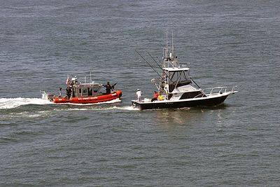 """""""Pull Over!""""  US Coast Guard Patrol Boat stopping civilian craft"""