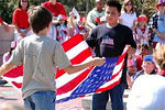 EGLIN AIR FORCE BASE, Fla. (AFPN) -- Fifth-graders fold the American flag during Oak Hill Elementary School's Veteran's Day walk. Oak Hill students have been doing the walk for 30 years.