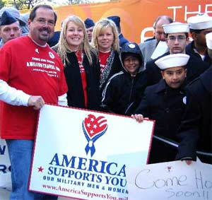 "Sixteen-year-old Shauna Fleming of Orange, Calif., (second from left), is flanked by her parents, Mike and Robin, and her brother, Ryan (wearing hood) Nov. 11 prior to a special Veterans Day edition of the CBS ""Early Show"" in New York city. Shauna's ""A Million Thanks"" program has resulted in deployed servicemembers receiving more than 1.4 million individual messages of gratitude for the American people."