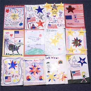 Knollwood Elementary School Veterans Day commemoration: Students from kindergarten through fifth grade classes presented beautiful, handmade bookmarks and letters they had prepared for veterans. The letters were artfully placed in patriotic book covers.