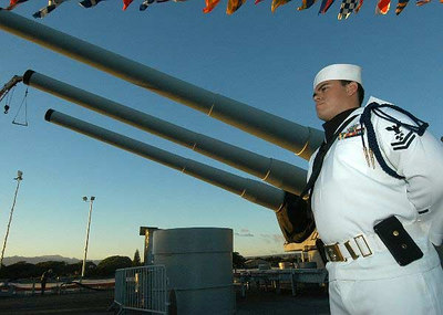 Machinist's Mate 2nd Class Ferlin Espinal, assigned to the Naval Station Pearl Harbor Ceremonial Color Guard, stands at parade rest aboard the Battleship Missouri Memorial during a Veterans Day Sunset Ceremony.
