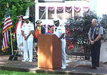PEARL HARBOR -- Navy Chaplain Capt. Nat Milton, delivers the invocation at a Veterans Day service held at the Submarine Base, as Commander Submarine Squadron One, Capt. Cecil D. Haney, and U.S. Submarine Veterans of World War II President Paul Ferguson, bow their head in silence.