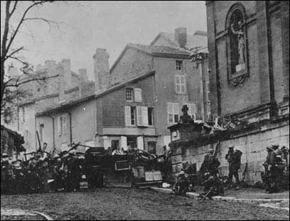 The history of Veterans Day: The last two minutes of fighting. Taken at 10:58 AM, 11 November 1918, just before the Armistice went into effect; men of the 353rd Infantry, near the church at Stenay, Meuse, wait for the end of hostilities.