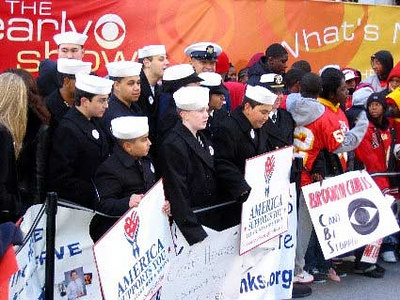"A group of military supporters carry ""America Supports You"" signs on Veterans Day in New York City."