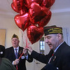Valentines Day 2017 Salute to Our Veterans Program at Bedford VA hospital. Jim Williams of the Tewksbury VFW, left, and VFW state commander Timothy Smith of Beverly, right, with balloons that were being distributed to patients. (SUN/Julia Malakie)