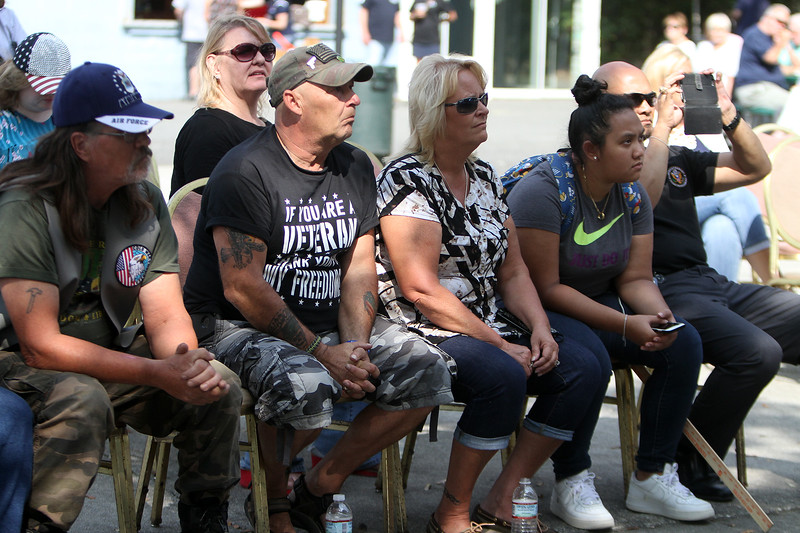 Veterans Assiting Veterans rally at Holy Ghost Park. Listening to speakers, from left, Michael Kelley of Wilmington, David and wife Linda Souci of Dracut, and Samantha Kay and Kamara Kay of Lowell. (SUN/Julia Malakie)