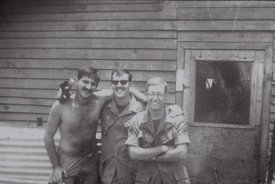 LTR SP4 Raymond Kazlas, SP4 Brian Peters, SP4 Fred J Freketic outside hootch Camp Radcliffe,RVN