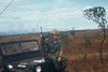 SP4 Fred J Freketic and HQ4<br /> outside Camp Enari and an<br /> unloaded M-16.