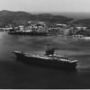 "This is an undated photograph of the the USS Saratoga (CVA-60) anchored at Guantanamo Bay.  As fate would have it, the ""Sara"" became my new home for 15 months after leaving Gitmo.  I remained aboard her until my release from active duty."
