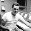 """Another shot of Bill Hemphill in the """"old"""" television control room.   While much of the television gear was decrepit, that RCA 77-DX microphone -- shown here -- did a fine job."""