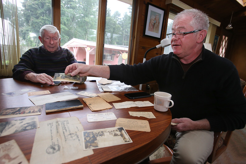 Tom Sexton Jr., 87, of Tewksbury, and his son Tom Sexton III, 58, of Hingham, with WWI memorabilia of Tom Sexton Sr., a US Army private in WWI. They plan to visit areas in France where he served.  (SUN/Julia Malakie)