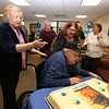 Gayle Gilbert, a WWII Navy veteran who lives at the Bedford VA and turns 100 on February 5, celebrates with family, friends and staff, including daughters Linda Wicks of Billerica, front left, and Donna Walker of Boxboro, center. (SUN/Julia Malakie)