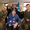 Gayle Gilbert, a WWII Navy veteran who lives at the Bedford VA and turns 100 on February 5, celebrates with family, friends and staff. Gilbert with, from left, Senior Chief Petty Officer (Seabees) Ron Stocker of Billerica, Engineering Aide 1st Class Sean Norton, US Navy, Lt. Brian Lusano, US Navy, of Londonderry, Sr. Chief Petty Officer Deanna Follis of Billerica and NEC Cadet (Jr ROTC) Colby Friesel, 15, of Greenland, N.H. (SUN/Julia Malakie)