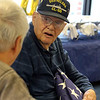 Gayle Gilbert, a WWII Navy veteran who lives at the Bedford VA and turns 100 on February 5, celebrates with family, friends and staff. Gilbert talks with his nephew Donald Simmons of Chelmsford, left. (SUN/Julia Malakie)