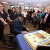 Gayle Gilbert, a WWII Navy veteran who lives at the Bedford VA and turns 100 on February 5, celebrates with family, friends and staff, including daughters Donna Walker of Boxboro, left, and Linda Wicks of Billerica, right. (SUN/Julia Malakie)