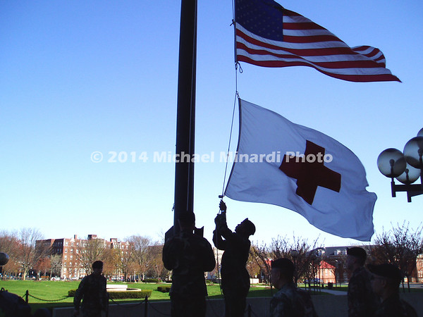 The flags are brought down and Taps are played12x9