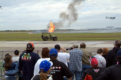 Bombs explode during the Tora! Tora! reenactment at the air show.