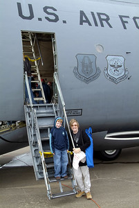 Wife and grandson in front of a C-5 Galaxy