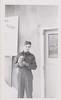 Lloyd Lantz in uniform with small dog