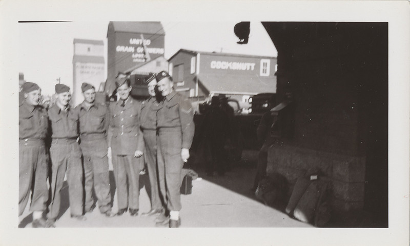 Lloyd and five others in uniform at train station