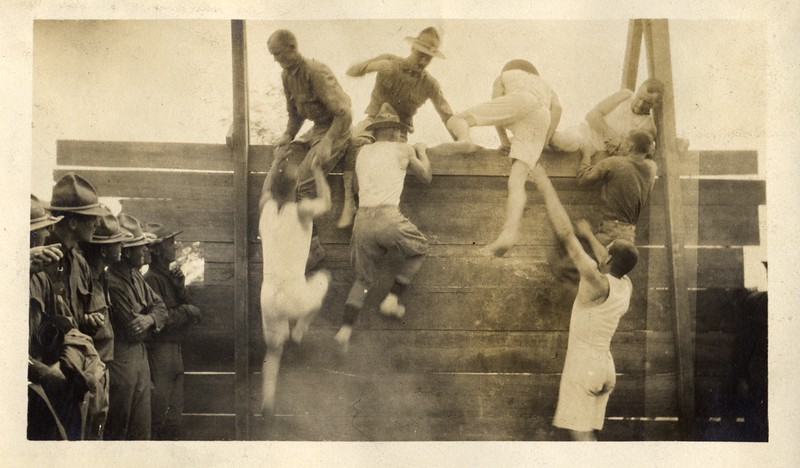 Men Climbing a Wall (03423)