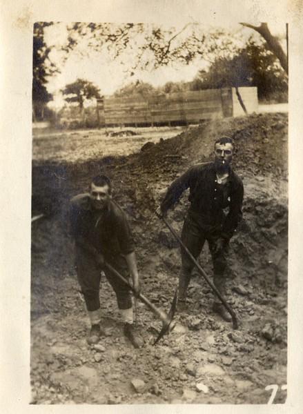 Two Men Shoveling (03439)