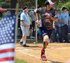 Wounded Warrior Amputee Softball Team member Axel Alicea hustles twoards first on a hit during the WWAST game against the Telford Fire Company at Franconia Park .Moyer threw out the first pitch of the contests on Saturday May 24,2014. Photo by Mark C Psoras/The Reporter