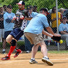 Wounded Warrior Amputee Softball Team member Axel Alicea scores a run during the WWAST game against the Telford Fire Company at Franconia Park .Moyer threw out the first pitch of the contests on Saturday May 24,2014. Photo by Mark C Psoras/The Reporter