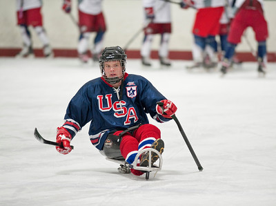 #20 Sergeant First Class Joe Bewser, US Army (Ret) takes to the hockey ring with is prosthetic leg as a result of his injuries in war.