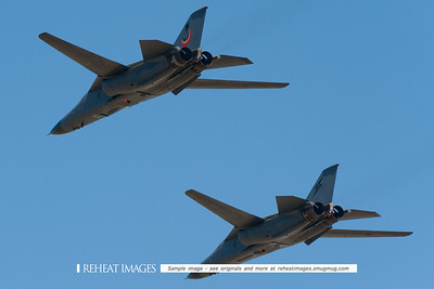 "Royal Australian Air Force General Dynamics F-111C ""Aardvark"" aircraft in formation, the left plane displaying the F-111 retirement motif."