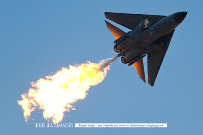 "Royal Australian Air Force General Dynamics F-111C ""Aardvark"" aircraft at 2010 Australian Defence Force Air show at Williamtown NSW performing the famous dump and burn, a spectacular sight that will no longer be seen after the retirement of the F-111C fleet at the end of 2010."