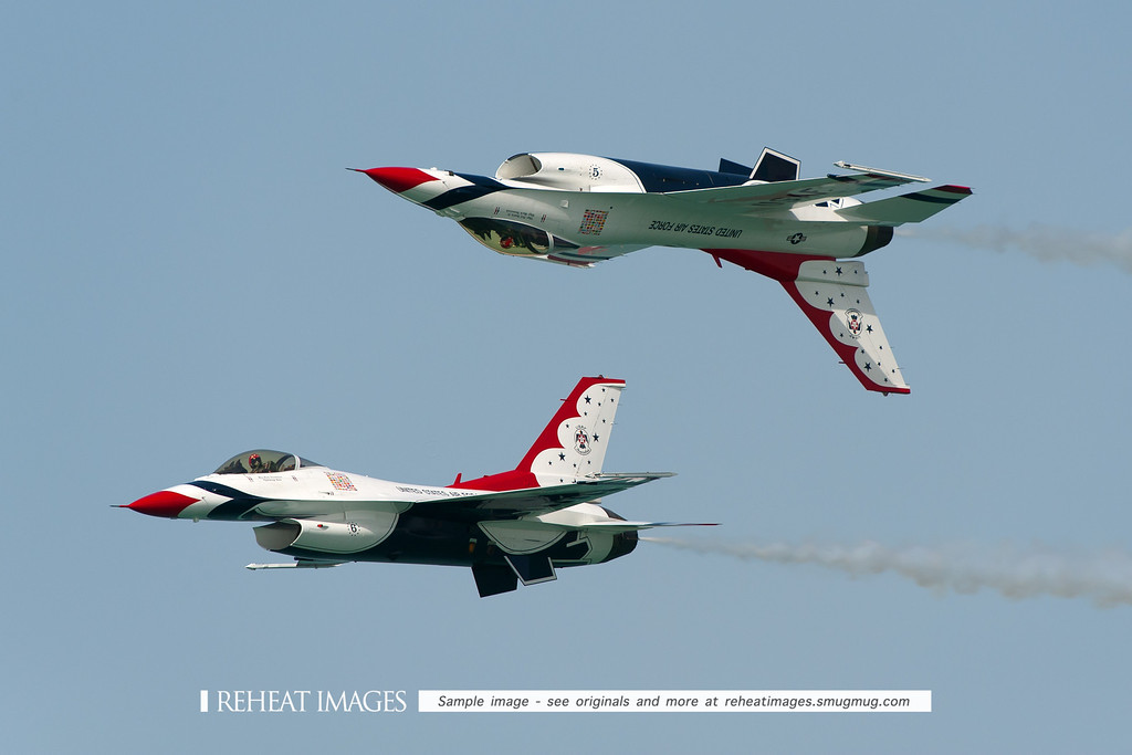 USAF Thunderbirds display team in Townsville at Australian Defence Force Air show 2009. The famous pass with one inverted, in formation with the other F-16 right way up - a favourite with crowds worldwide.