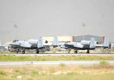 A-10 Thunderbolts taxi the runway at Bagram Airfield