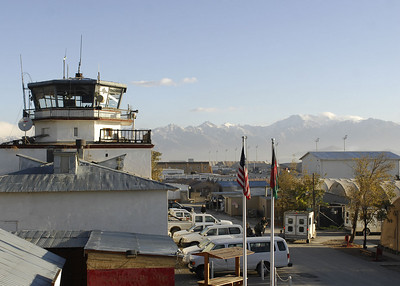 Beautiful mountains in Afghanistan are visible behind the old Russian Control Tower, known as the Crow's Nest.  The Russian Control Tower was built in 1976 during the Soviet Union's occupation of the region.  Currently 28,300 U.S. troops are deployed to Bagram supporting Operation Enduring Freedom and NATO International Security Assistance Forces.
