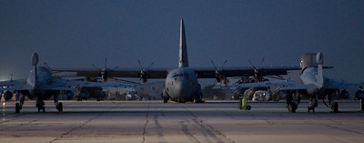 A C-130J Hercules stands ready on the tarmac in Bagram Airfield. C-130s make up the bulk of the airlift mission at Bagram, being the only fixed-wing cargo airframe capable of landing on a dirt runway.