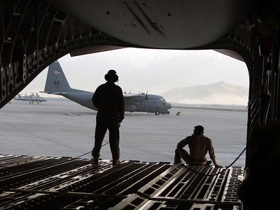 Airmen survey the airfield here after their C-17 Globemaster III taxis to a stop here.