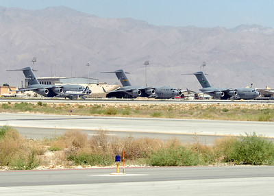 Three C-17s sit on the flight line and await take off here. The C-17s are deployed from Travis Air Force Base, Calif. (left), Charleston AFB, S.C. (middle), and McChord AFB, Wash. (right). The C-17 is capable of rapid strategic delivery of troops and all types of cargo to main operating bases or directly to forward bases in the deployment area. While the C-17's primary mission is to perform airlift and airdrop missions it can also transport litters and ambulatory patients during aeromedical evacuations when required.