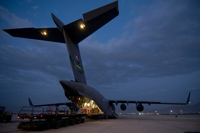Cargo being unloaded from a C-17 Globemaster III. The flexible aircraft provides rapid intra-theater cargo, airdrop, and aero-medical evacuation support throughout southwest Asia.