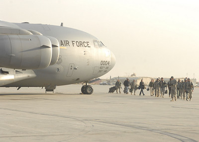 Troops disembark from a C-17 Globemaster III. C-17's carry a maximum of 170,900 pounds, and can land on runways as short as 3,500 feet.