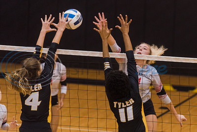 Trinity Valley Community College's Lauren Castles (24) hits the ball as Tyler Junior College's Audrey Gun (4) and Shara De Silva (11) attempt to block during game action Friday, Nov. 1, 2019, at Wagstaff Gym in Tyler. (Cara Campbell/Tyler Morning Telegraph)