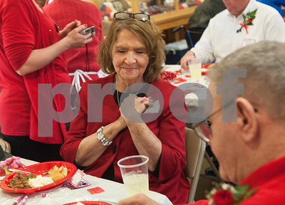 Ronda Weems closes her eyes as she listens to a song with her husband, veteran Kerry Weems, right, at the Watkins-Logan Texas State Veterans Home Sweetheart Luncheon Friday Feb. 12, 2016. Veterans at the home attended the luncheon with their spouses, dates, or family members.   (Sarah A. Miller/Tyler Morning Telegraph)