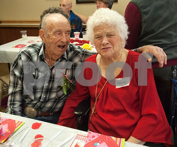 Friends Odell Taylor and Wanda Engle dine together at the Watkins-Logan Texas State Veterans Home Sweetheart Luncheon Friday Feb. 12, 2016. Taylor is a World War II Navy veteran and Engle's late husband Archer Engle was also a WWII veteran.  (Sarah A. Miller/Tyler Morning Telegraph)