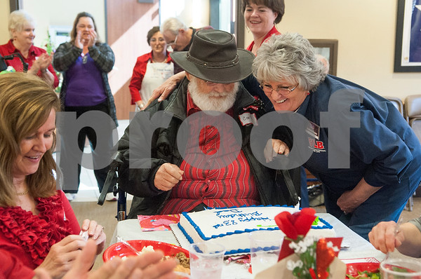 Donna Huffman of Veterans Land Board hugs resident Navy veteran Carl Terry as he celebrates his 83rd birthday with a cake at the Watkins-Logan Texas State Veterans Home Sweetheart Luncheon Friday Feb. 12, 2016. Veterans at the home attended the luncheon with their spouses, dates, or family members.   (Sarah A. Miller/Tyler Morning Telegraph)