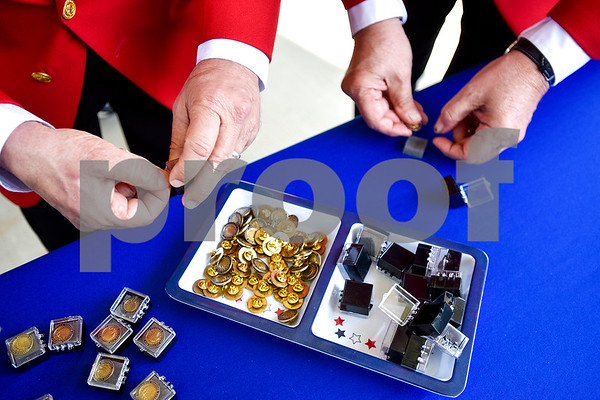Southern Division Marine Corps League members Johnny Gothard and Chuck Tompkins prepare pins during a ceremony honoring Vietnam veterans at Watkins-Logan Texas State Veterans Home in Tyler, Texas, on Friday, March 24, 2017. Dozens of Vietnam veterans received special commemorative pins honoring their service. (Chelsea Purgahn/Tyler Morning Telegraph)