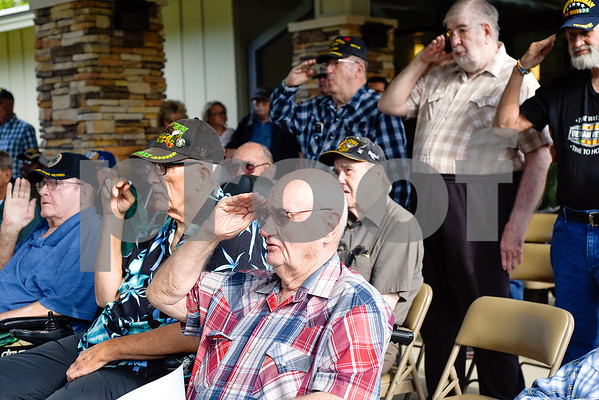 Veterans salute the American flag during a ceremony honoring Vietnam veterans at Watkins-Logan Texas State Veterans Home in Tyler, Texas, on Friday, March 24, 2017. Dozens of Vietnam veterans received special commemorative pins honoring their service. (Chelsea Purgahn/Tyler Morning Telegraph)