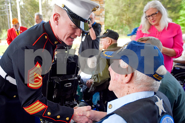 Gunnery Sergeant Thomas Stewart shakes hands with Ed Coggeshall after presenting Coggeshall with a pin during a ceremony honoring Vietnam veterans at Watkins-Logan Texas State Veterans Home in Tyler, Texas, on Friday, March 24, 2017. Dozens of Vietnam veterans received special commemorative pins honoring their service. (Chelsea Purgahn/Tyler Morning Telegraph)