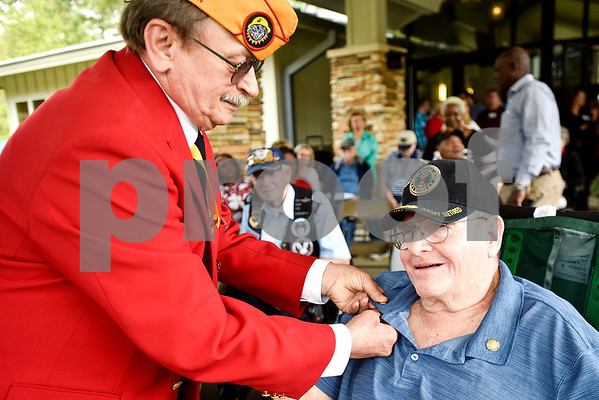 Johnny Gothard, assistant national vice commandant in the Southern Division Marine Corps League, presents Kerry with a pin during a ceremony honoring Vietnam veterans at Watkins-Logan Texas State Veterans Home in Tyler, Texas, on Friday, March 24, 2017. Dozens of Vietnam veterans received special commemorative pins honoring their service. (Chelsea Purgahn/Tyler Morning Telegraph)