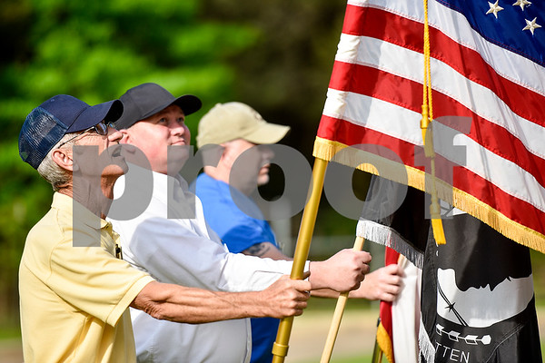Sergeant first class Jeff Young looks up at the American flag as he, Sergeant Dough Randolph and Corporal Gary Johnson post colors during a ceremony honoring Vietnam veterans at Watkins-Logan Texas State Veterans Home in Tyler, Texas, on Friday, March 24, 2017. Dozens of Vietnam veterans received special commemorative pins honoring their service. (Chelsea Purgahn/Tyler Morning Telegraph)