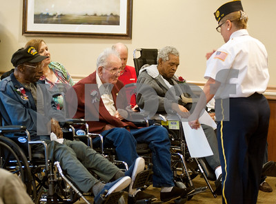 photo by Sarah A. Miller/Tyler Morning Telegraph  Linda Reed of the American Legion Post 474 gives certificates to a group of Vietnam Era Veterans Friday during a recognition ceremony at the Watkins-Logan Texas State Veterans Home in Tyler.